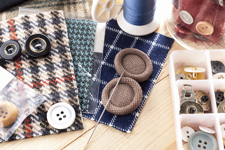 sewing kit: Sewing kit stuff - buttons colorful fabrics and sewing needles