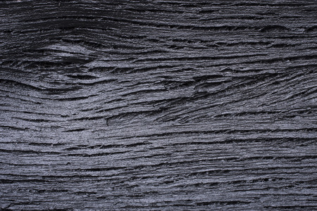 Backgrounds and texture of black wooden charcoal photo