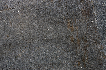 Grey grunge sandpaper texture with detail surface photo