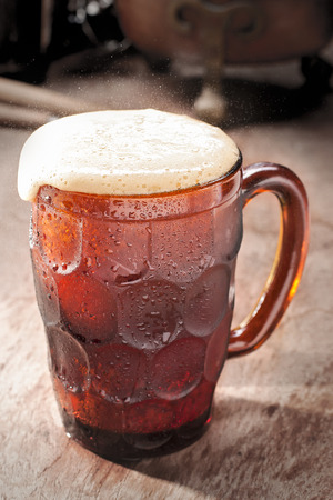 root beer: Cold Refreshing Homemade Root Beer with Foam in a Mug Stock Photo