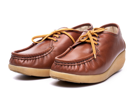 Brown leather Boat Shoes  isolate on white background photo