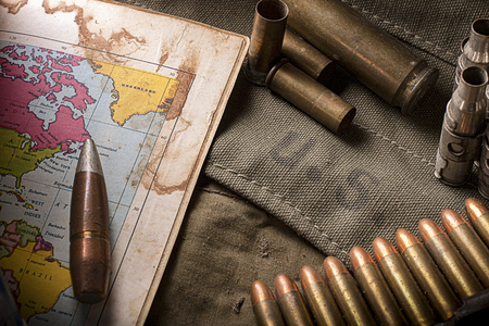 Elements of the US Army ammunition with old map.selective focus
