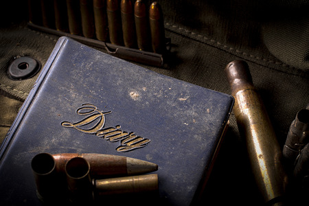 old diary: Old Diary of The War with elements of ammunition. Stock Photo