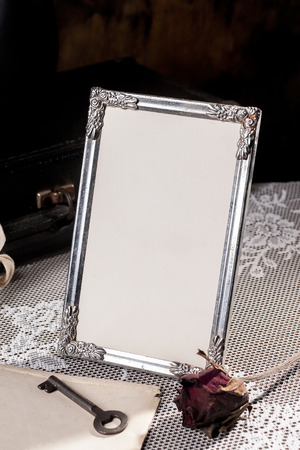 Vintage picture frame on the table.(focus of the inner space) Фото со стока - 55487952