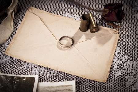 Concept of loss a love with vintage envelope and wedding ring. Фото со стока