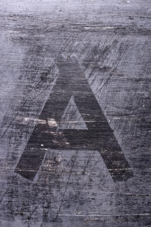 Black grunge alphabet sticky tape effect.Letter A Фото со стока
