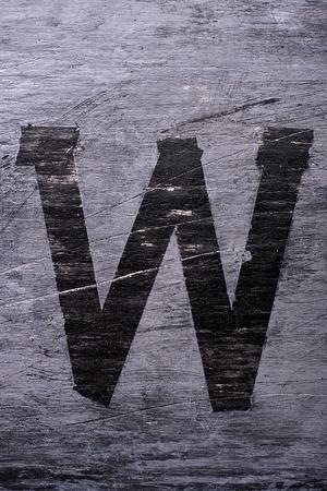 Black grunge alphabet sticky tape effect.Letter W
