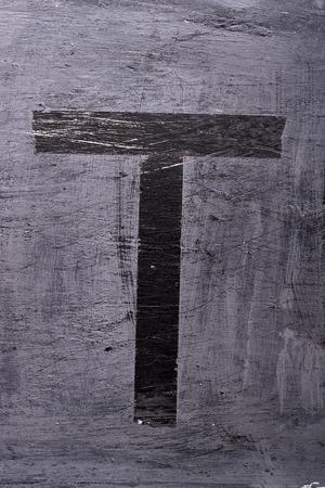 Black grunge alphabet sticky tape effect.Letter T