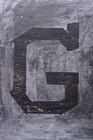 Black grunge alphabet sticky tape effect.Letter G