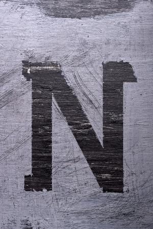 Black grunge alphabet sticky tape effect.Letter N