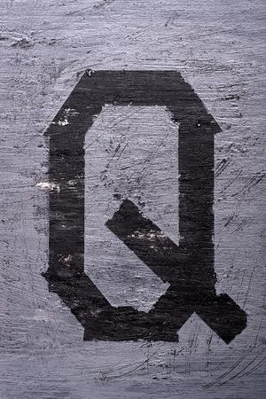 Black grunge alphabet sticky tape effect.Letter Q Фото со стока