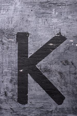 Black grunge alphabet sticky tape effect.Letter K