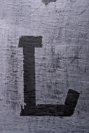 Black grunge alphabet sticky tape effect.Letter L
