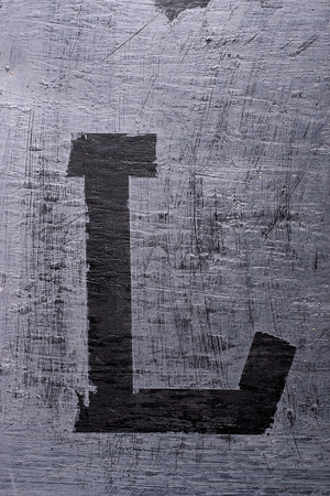 Zwarte grunge alfabet plakband effect.Letter L Stockfoto