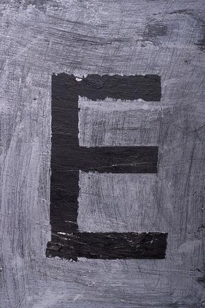 Black grunge alphabet sticky tape effect.Letter E Фото со стока