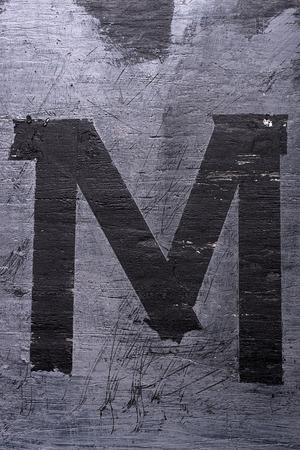 Black grunge alphabet sticky tape effect.Letter M Фото со стока