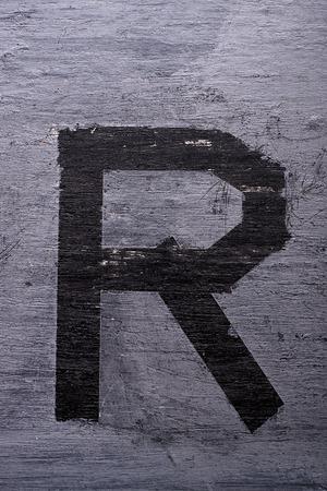 Black grunge alphabet sticky tape effect.Letter R