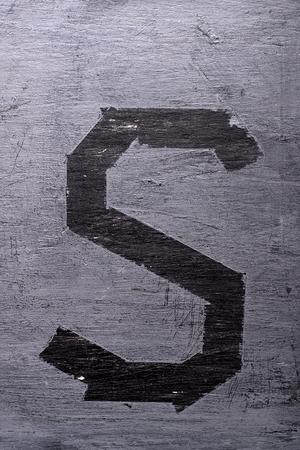 Black grunge alphabet sticky tape effect.Letter S