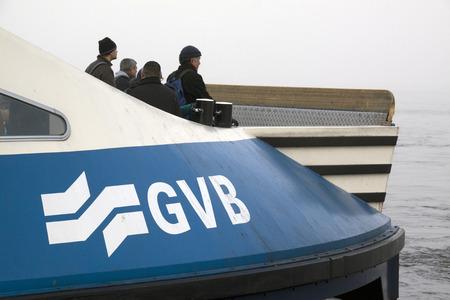 veer: Ferry Amsterdam  front IJ in misty weather
