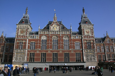 weather front: 15 february 2015, Amsterdam the Netherlands front of the central railway station in Amsterdam, in the towers there are a clock and an weather vane