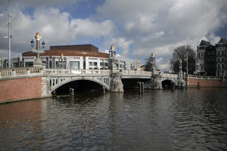 amstel river: Amsterdam, the Netherlands, february-22-2015 The Blue Bridge (bridge no. 236) in Amsterdam is a bridge over the Amstel River, which connects the Rembrandtplein area with the Waterlooplein.