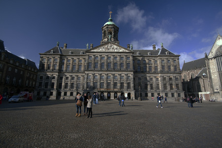 dam square: Amsterdam, the Netherlands, february-22-2015 The Royal Palace on dam Square, used by the royal family for meetings