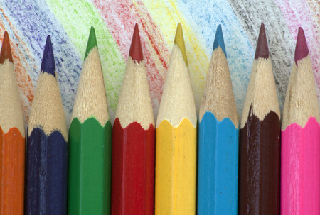 eight pencils on a colourful background