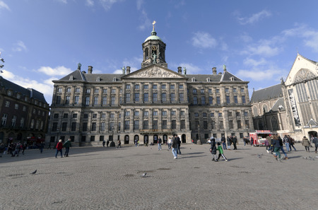 dam square: Amsterdam,The Netherlands-march 1,2015: The Royal Palace at the Dam Square in Amsterdam