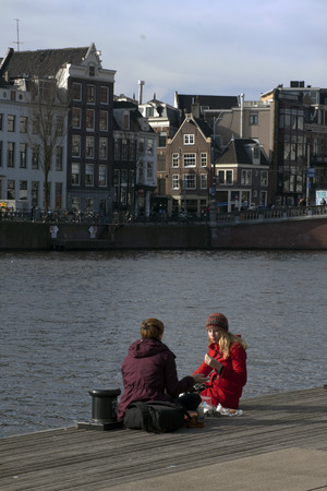 nick: Amsterdam,The Netherlands-march 7,2015: Enjoying the winter sun at the amstel in Amsterdam and pick nick Editorial