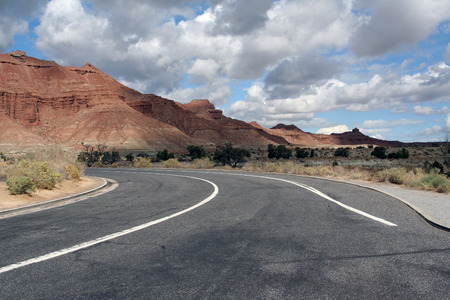 on the lonely road: nevada,USA-october 5,2014: lonely road bend in Nevada, USA in the background mountains Editorial