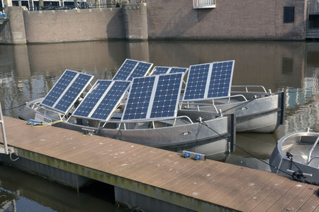 converts: Amsterdam,The Netherlands-march 16,2015: A solar panel or photovoltaic panel, known as PV panel is a panel that converts solar energy into electricity. these panels are mounted on a boat