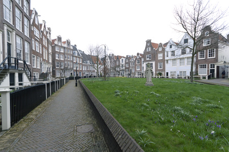 almshouse: Amsterdam,The Netherlands-march 23,2015: begijnhof in Amsterdam full view. The Begijnhof in Amsterdam is the only medieval almshouse founded in Amsterdam, located within the Singel.