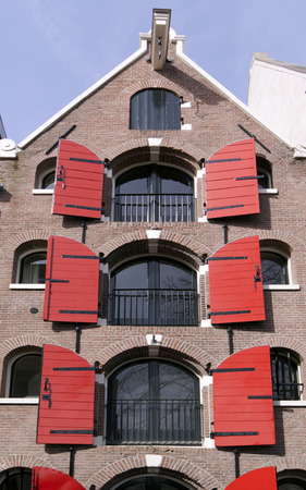 canal house: Amsterdam ,Netherlands-april 12, 2015: Window shutters at a amsterdam canal house Editorial