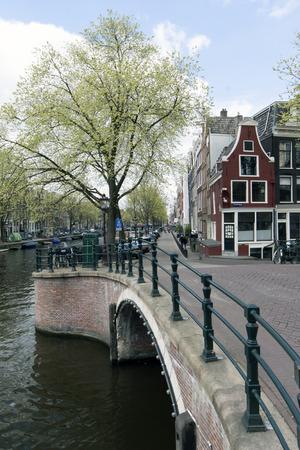 prinsengracht: Amsterdam,netherlands-april 19, 2015: canal in amsterdam with bridge, prinsengracht, reguliersgracht