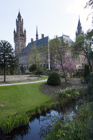 arbitration: THe Hague , The Netherlands-april 30, 2015: The Peace Palace is the seat of the Permanent Court of Arbitration, the International Court of the United Nations, the Hague Academy of International Law, the Peace Palace Library and the Carnegie Foundation Editorial