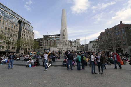 dam square: Amsterdam netherlandsmay 8 2015: Dam Square in Amsterdam with tourists and the National Monument to commemorate World War II in Netherlands Editorial