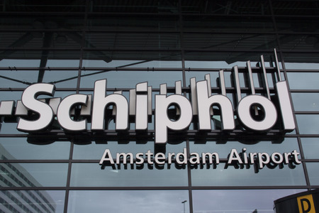 schiphol: Amsterdamnetherlandsmay 12 2015: Main entrance of Schiphol international airport of Amsterdam Hoilland Editorial