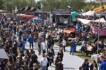 Amsterdamnetherlandsmay 17 2015: People at the food truck or rolling kitchen festival in Amsterdam