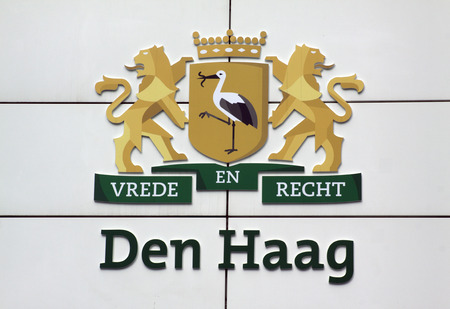 city coat of arms: The Haguenetherlandsmay 20 2015: City coat of arms of the hedge at the town hall in the hague with text Peace and Justice and stork