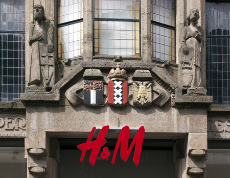 hm: Amsterdamnetherlandsmay 27 2015: HM sign on a classic facade of a building in Amsterdam Netherlands