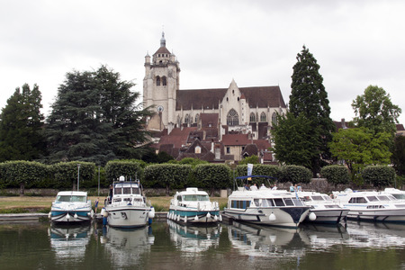 on the dole: Dole,france-june 13, 2015: tanners district and the Notre-Dame de Dole in France with boats in the river Editorial