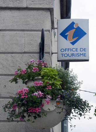 on the dole: Dole,france-june 14, 2015: sign of the tourist office in dole france with flowers in a bucket Editorial