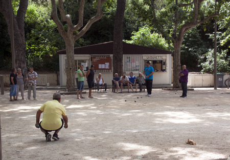 bedoin,france-june 21, 2015: people playing ball game in bedoin France