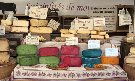 arles: bedoin,france-june 3, 2015: colorful french cheese at the market in Arles
