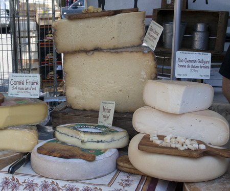 flatter: arles,france-june 3, 2015: french cheese displayed for sale at the market in Arles france
