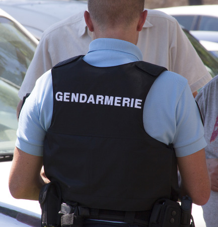 bedoin: bedoin,france-june 28, 2015: The Gendarmerie Nationale is a semi-military police force in France,this officer wears an bullet proof jacket Editorial
