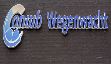 road assistance: Amsterdam, Netherlands-July 22, 2015: Sign of the dutch ANWB road assistance on a wall in Amsterdam