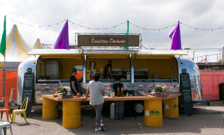 airstream: Amsterdam,Netherlands-july 31, 2015: airstream caravan in use as a food truck selling couscous in Amsterdam