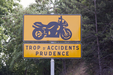 2 way: avignon,france-july 2, 2015: Warning sign for motorcycles because there are many accidents on the way to lamaste in france Editorial