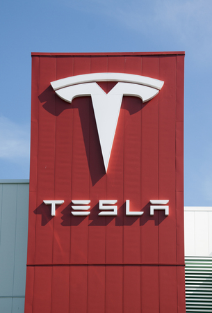 electric vehicle: Amsterdam , Netherlands-august 30, 2015: Tesla logo on the tesla service station in Amsterdam Editorial